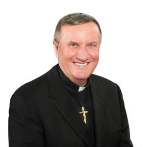Fr. Janusz Błażejak OMI (pastor)